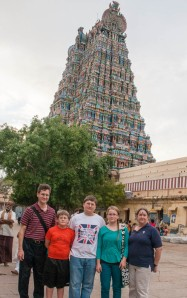 Family portrait with one of the gopurams.