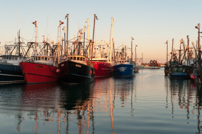 Fishing ships docked at the New Bedford pier.