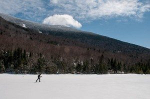 Mark skis across Mud Pond while a cloud pauses above Moosilauke's south peak.