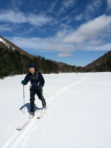 David skis across the ponds along the Tunnel Brook trail.