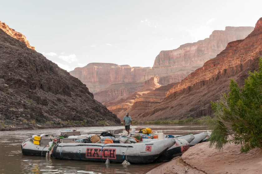 JP readies the boats as the morning sun paints the canyon walls behind; Camp 4.