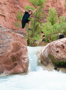 Andy leaps into a pool at Havasu Creek.