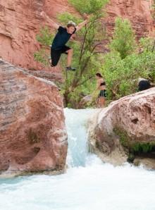 Andy leaps into a pool at Havasu Creek.