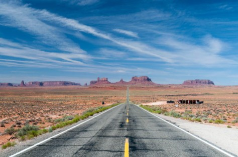 Driving through Monument Valley; some craft vendors set up alongside the road.