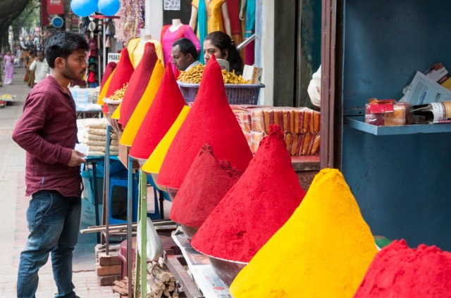 photos of carefully piled powder, red and yellow