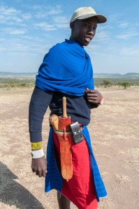 The waistbelt of a modern Maasai warrior/ranger includes a wooden club, a machete, and a cellphone. Enashiva reserve, Tanzania.