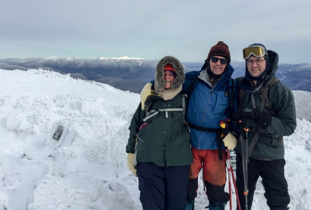Jen, Lars and David enjoy calm weather on the summit of Mount Moosilauke. Photo by Jen Botzojorns.