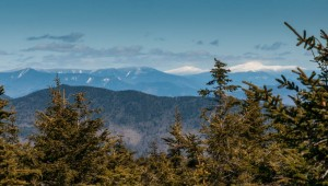 The Presidentials, with a fresh coat of white snow, dominate the view from Mount Carr.