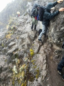 David (white hat brim) navigates an exposed section of the Barranco Wall. Photo by Ken Kaliski.