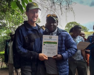 David receives his certificate from James, head guide. Photo by Ken Kaliski.