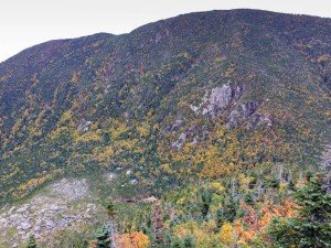 A morning view into Carter Notch, with the hut and ponds visible at bottom, and Wildcat ridge behind, from an outlook on the climb up to Carter Dome.