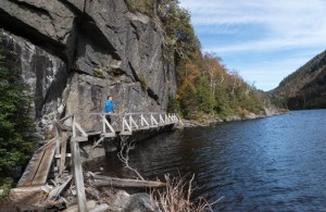 "David on ""hitch-up Matilda"" bridges alongside Avalanche Lake."