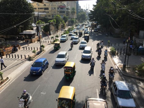 Bangalore traffic on Residency Road. Notice the new sidewalks, with barrier posts to prevent people from driving on sidewalks.