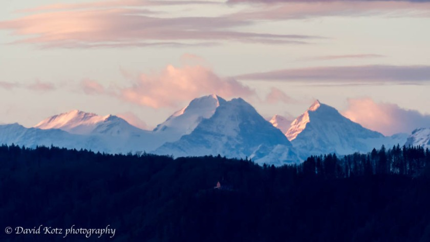 Trugberg, Mönch, Eiger, and Jungfrau, as seen from Zürichberg at sunrise.
